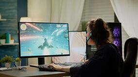 Free Player Sitting On Gaming Chair Playing Online Space Shooter Video Games Stock Photos - 216663303