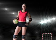 Player standing and holding handball in stadium. Portrait of player standing and holding handball in stadium Royalty Free Stock Images