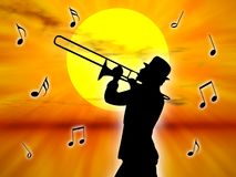Player in the sunset. A trumpet player in the sunset against the sun Royalty Free Stock Photo
