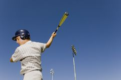 Player Swinging Baseball Bat Royalty Free Stock Images