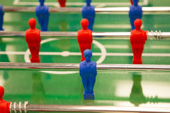 Player in table football. A red and blue football player from table game royalty free stock photos