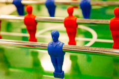 Player in table football. A red and blue football player from table game royalty free stock images