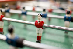 Player in table football. A withe and orange football player from table game stock photo