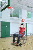 Player throwing ball at the basket Royalty Free Stock Image