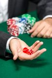 Player throws dices on the poker table Royalty Free Stock Image