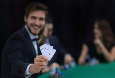 Player to the casino with a combination of four aces. The concept of fortune Stock Photography