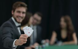 Player to the casino with a combination of four aces. The concept of fortune Stock Image