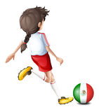 A player using the ball with the flag of Mexico Stock Photography
