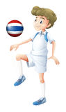 A player using the ball with the flag of Thailand Royalty Free Stock Images
