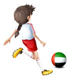 Player using ball with flag of the UAE Royalty Free Stock Photo