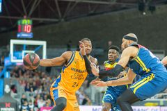 Players in action at Liga Acb Endesa match between Mora Banc Andorra BC and Herbalife Gran Canaria , final score 99 - 85, on March royalty free stock photography