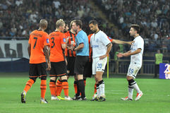 Players arguing with referee Stock Images