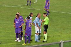 Players arguing with the referee over a yello card Stock Image