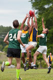 Players Battle For Ball In Australian Rules Football Game Royalty Free Stock Photos