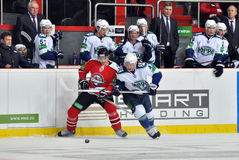 Players from both teams are fighting for the puck Stock Photo