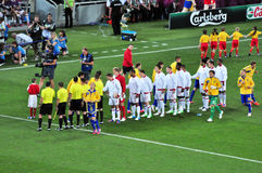 Players from both teams greet each other Royalty Free Stock Images