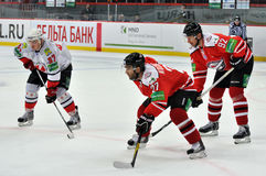 Players from both teams are waiting for the puck Stock Images