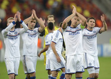 Players of Chelsea applauding. Chelseas players, John Terry, Frank Lampard, Branislav Ivanovic and Andre Schurrle applauding the supporters, at the end of the Royalty Free Stock Photo