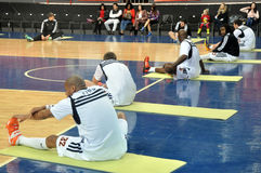 Players doing stretching before the game Royalty Free Stock Image