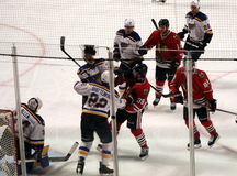 Players Fight During Chicago Blackhawks Hockey Game. A fight breaks out between a member of the Chicago Blackhawks, Ryan Hartman, and a member of the St. Louis royalty free stock photo