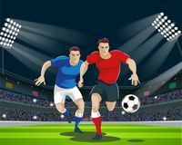 Players are fighting for the ball in stadium. Light, stands, fans. Royalty Free Stock Photography