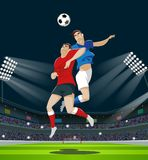 Players are fighting for the ball in stadium. Light, stands, fans. Royalty Free Stock Photos