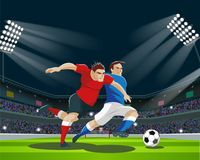 Players are fighting for the ball in stadium. Light, stands, fans. Stock Images