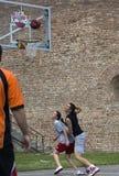 Players follow flight of the ball-1 Stock Image