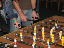 Players at Foosball Table Royalty Free Stock Photography