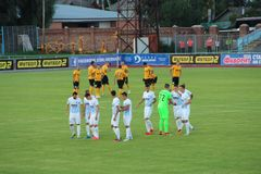 Players of football club Desna Chernihiv are tuned to game embracing in circle royalty free stock images
