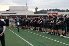 Players at high school football game. Players gathering at the field on a high school football game royalty free stock photos