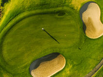 Players on a green golf course Royalty Free Stock Photography