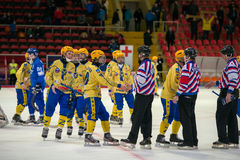Players greeting the referees. MOSCOW - FEBRUARY 26, 2016: players greeting the referees at the end the Russian bandy league game Dynamo Moscow vs Sharp Royalty Free Stock Photography