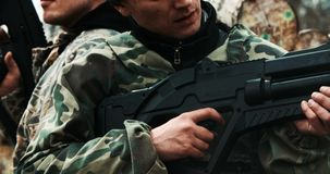 Players with guns on during LaserTag stock footage