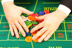 Players hands and chips Royalty Free Stock Photography