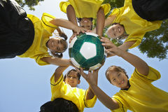 Players Holding Soccer Football. Low angle view of female players holding soccer ball Royalty Free Stock Photos