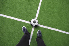 Players legs with soccer ball on soccer field. Point of view of a player man legs with soccer ball on sunny soccer field. Concept football play background royalty free stock photos