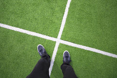 Players legs on soccer field with lines Stock Image