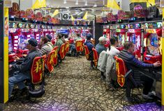 Players in a pachinko hall, Tokyo, Japan stock images