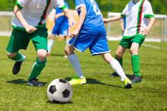Players play football soccer match. Football match for children. Training and football soccer competition tournament Stock Images
