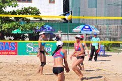 Players are playing in a match in the Women beach volleyball tournament in Nha Trang city Stock Photos