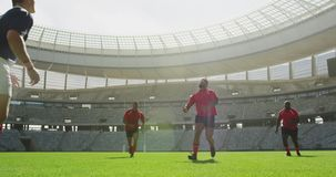 players playing rugby match in stadium 4k stock video footage