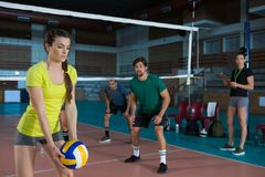 Players playing volleyball at court Royalty Free Stock Image