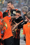 Players poured champagne into the cup Royalty Free Stock Images