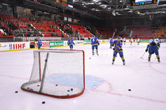 Players practice throwing puck into the goal Royalty Free Stock Images