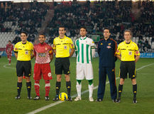 Players and referees in initial alignment Stock Images