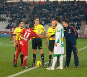 Players and referees in initial alignment Stock Image