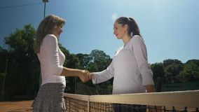 Players shaking hands after a tennis match stock video