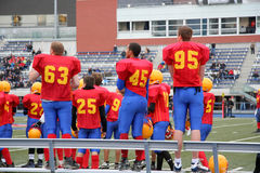 Players on sidelines at high school football game Royalty Free Stock Photos