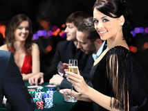 Players Sitting Around A Table At A Casino Royalty Free Stock Photography